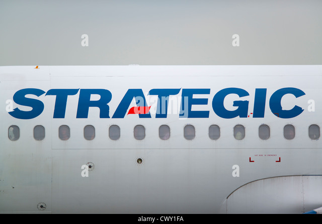 A close up of the Strategic logo on the fuselage of a passenger aircraft (Editorial use only) - Stock Image
