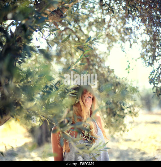 Greece, Dodecanese Prefecture, South Aegean, Woman standing in garden - Stock Image