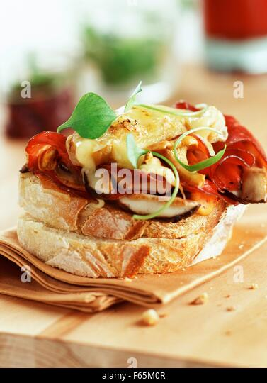 Rocamadour cheese and mushroom open sandwich - Stock Image