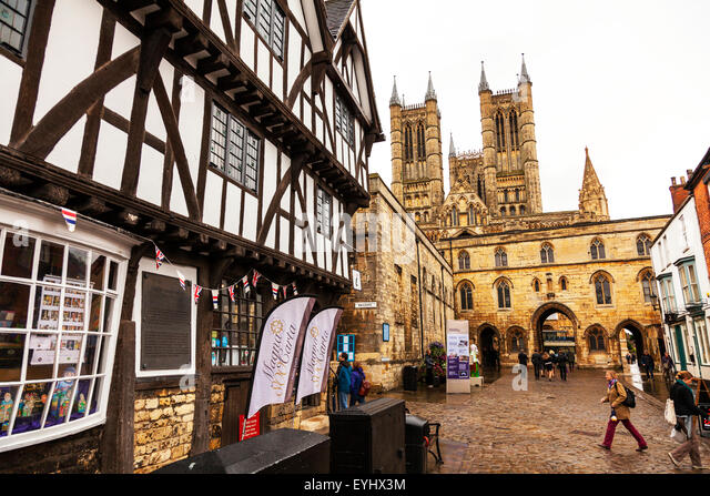 Lincoln Cathedral from Castle Hill Lincoln City Lincolnshire UK England  Leigh Pemberton House a Tudor half-timbered - Stock Image