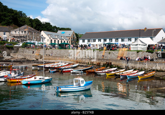 A gig rowing event in Porthleven, Cornwall UK. - Stock Image