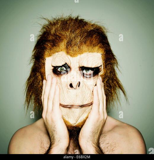 man,humor,bizarre,gorilla,monkey mask - Stock Image