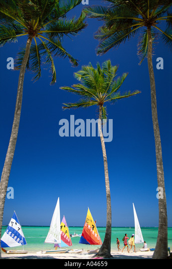 Dominican Republic Punta Cana Beach palm trees and sailboats - Stock Image