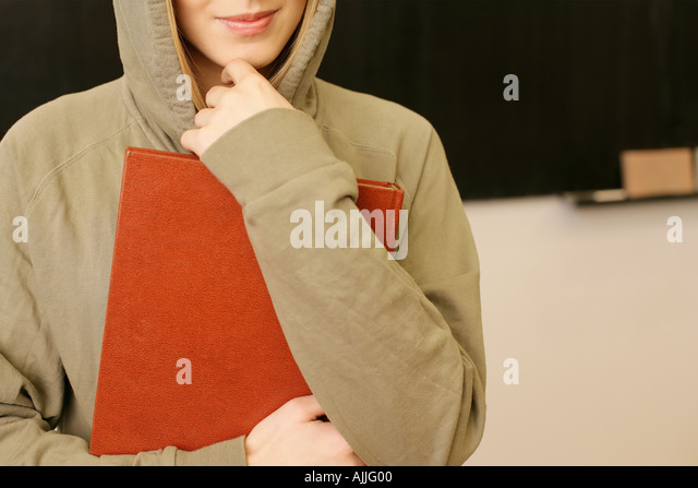 Young woman in a hooded sweater - Stock Image