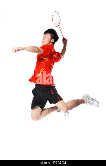 Male athletes playing badminton - Stock Image