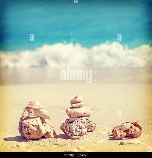 Vintage retro style image of coral pyramids on beach, Zen spa concept background. - Stock-Bilder