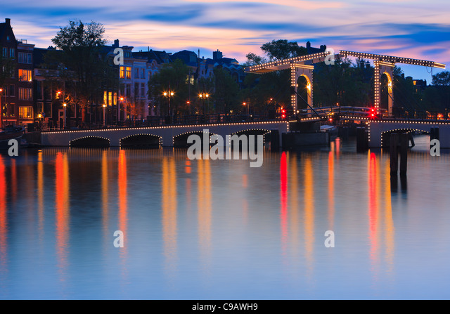 Blue Hour Amsterdam with the view on the Magere Brug (Skinny Bridge) after sunset. - Stock Image