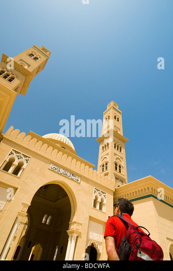 Foreign tourist sightseeing Sultans Qaboos mosque near Bahla sultanate of Oman - Stock Image
