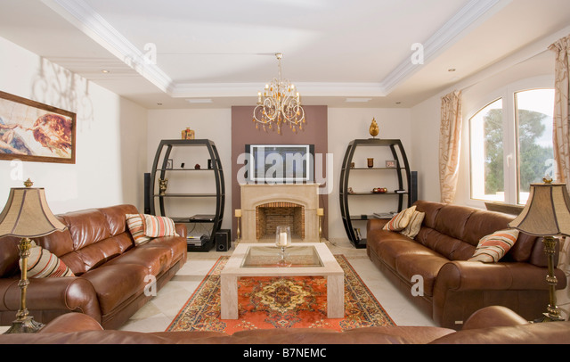 Television Above Fireplace In Modern Spanish Living Room With Large