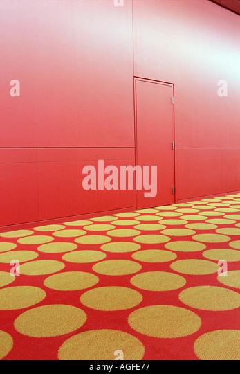 Patterned carpet in red corridor - Stock-Bilder