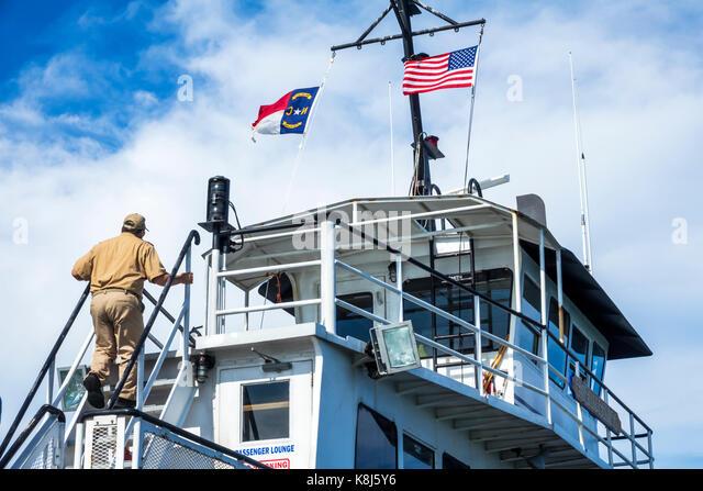 North Carolina NC Outer Banks Pamlico Sound Ocracoke Island Hatteras ferry boat bridge ladder crewman climbing - Stock Image