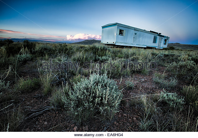 Deserted mobile home in remote field - Stock Image