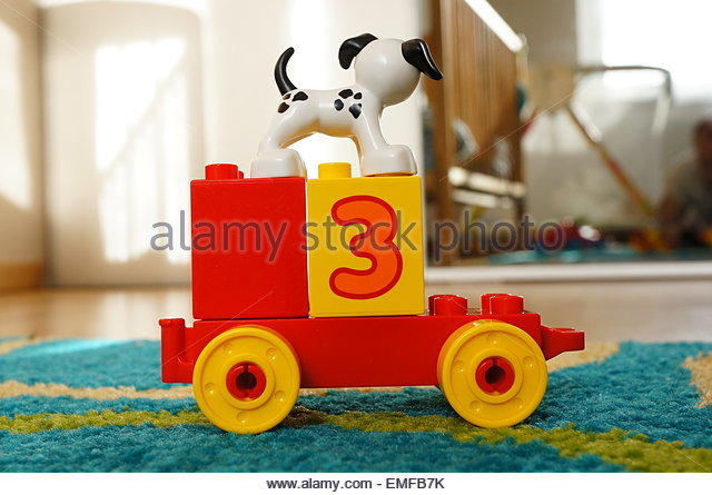 Lego Duplo toy cart with dog and blocks - Stock Image