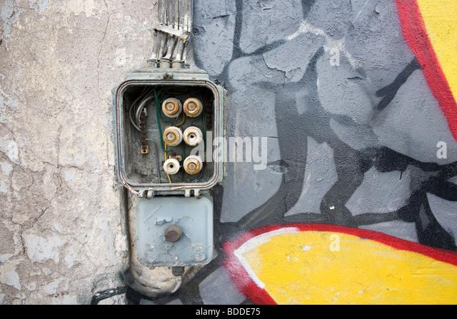old fuse box on abandoned warehouse wall - Stock Image