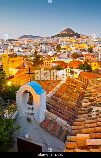 View of Lycabettus hill and a small Greek orthodox church in Anafiotika, Athens. - Stock Image