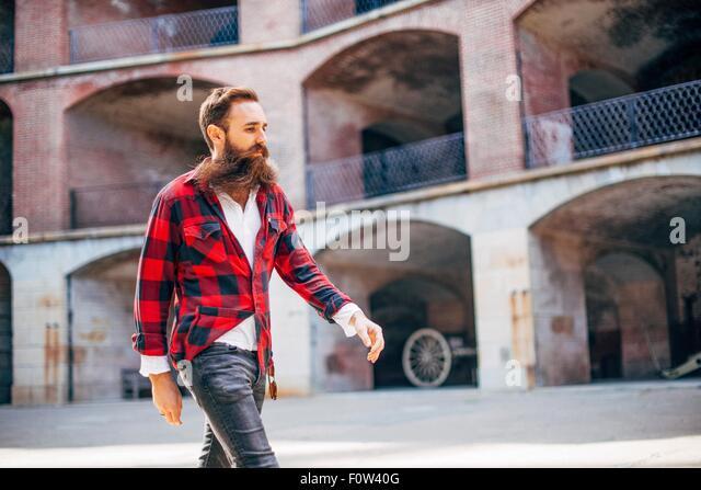 Man with beard walking - Stock-Bilder