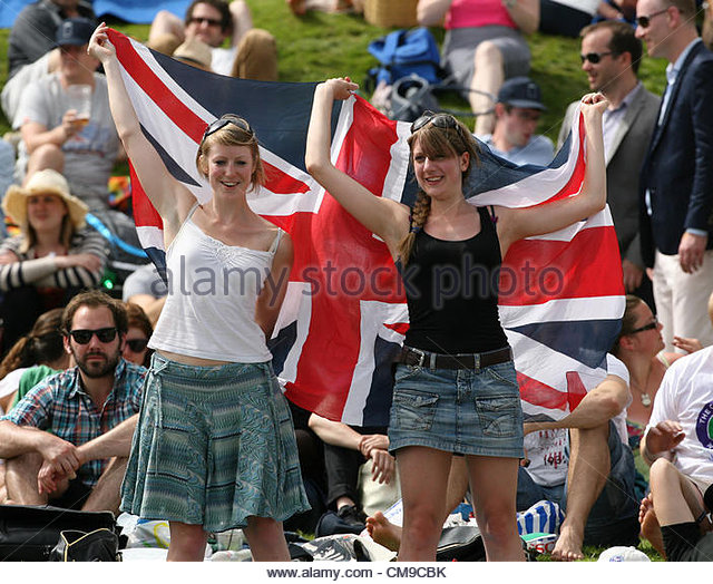 28/06/2012 - Wimbledon (Day 4) - Female supporters of Andy Murray wave their Union Jack flag on the Aorangi Terrace, - Stock-Bilder