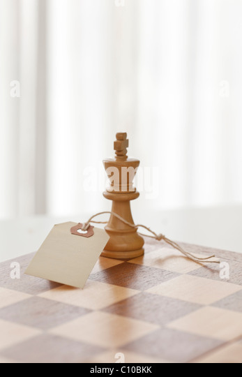 chess piece king with price tag attached - Stock Image