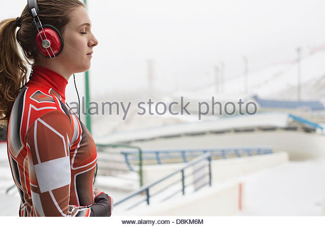 Female luge athlete preparing for race - Stock Image