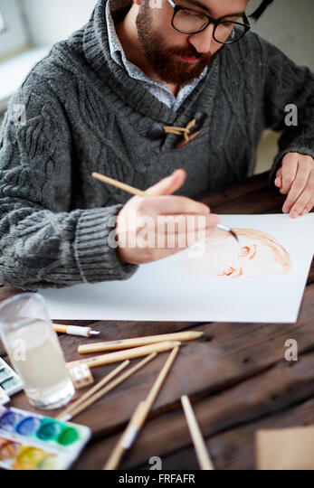 Man painting - Stock Image