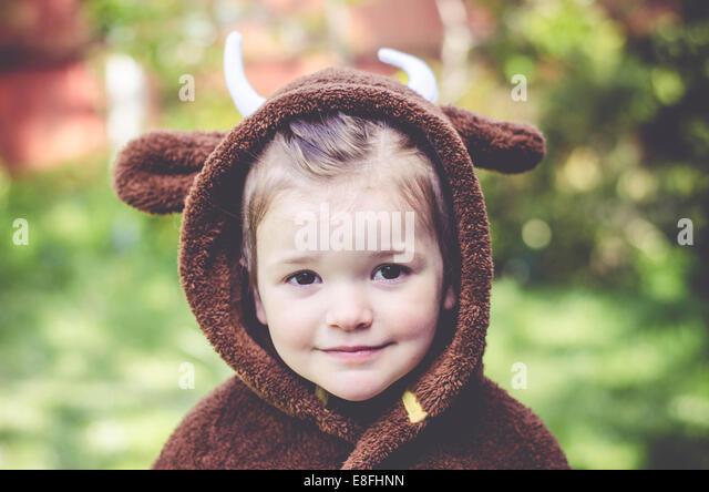 Girl wearing costume of Gruffalo - Stock Image