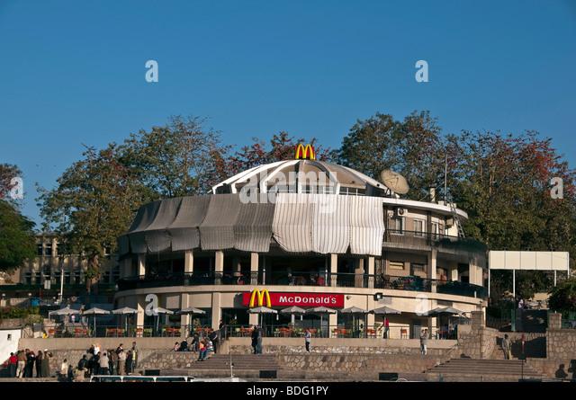McDonald's hamburger fast food restaurant Aswan Egypt on Nile River large bright building - Stock Image