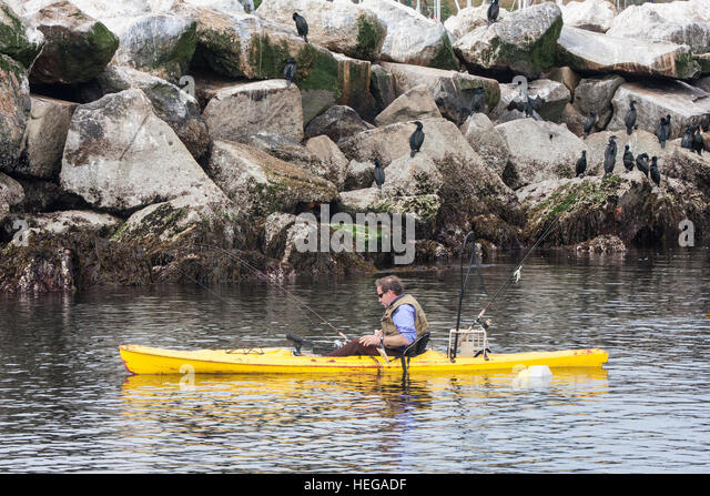 Fishing angling from well equipped Sea kayak at Monterey,Monterey Bay,California.USA,United States of America. - Stock Image