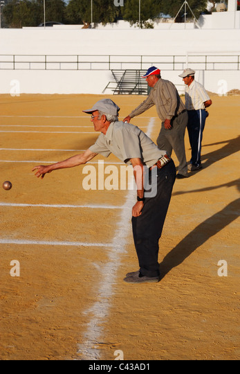 Spanish men playing Petanca in Andalucia - Stock Image