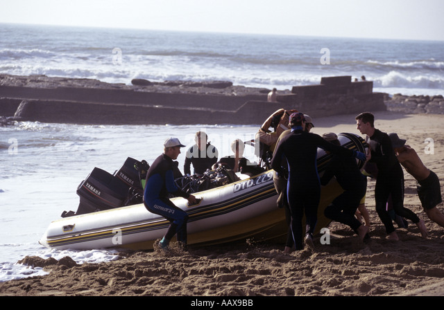 Launching Rigid Inflatable with divers in Durban South Africa - Stock Image