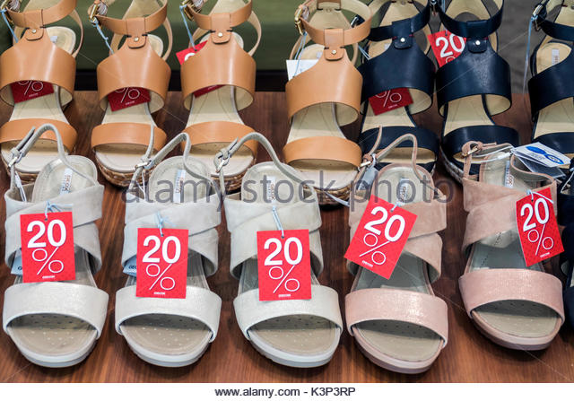 Lisbon Portugal Rossio Square Pedro IV Square shoes store shopping sandals discount display sale - Stock Image