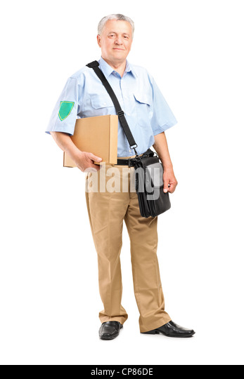 Full length portrait of a mature postman delivering a box isolated on white background - Stock Image
