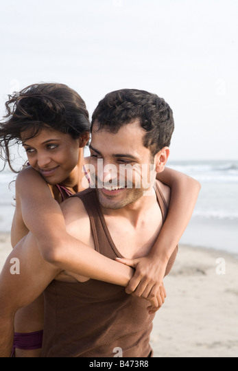 Happy couple at beach - Stock-Bilder