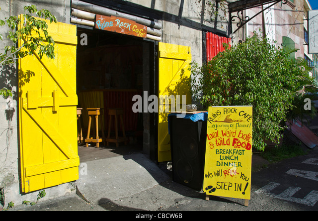 Ruins Rock cafe entrance with 'local weird exotic & wild food,' Roseau Dominica - Stock Image
