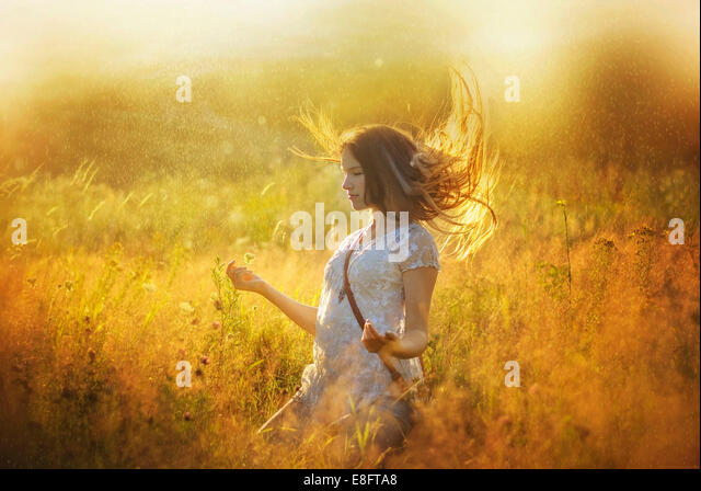 Girl meditating outdoors - Stock Image