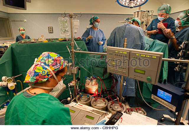 Doctors implant an aortic heart valve. - Stock Image