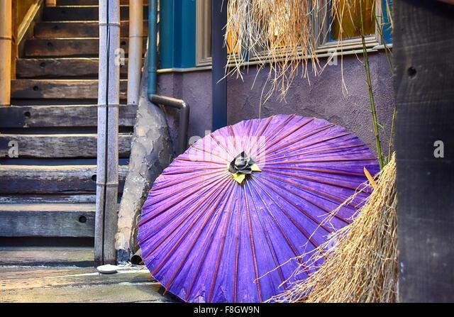 Umbrella in doorway - Stock Image