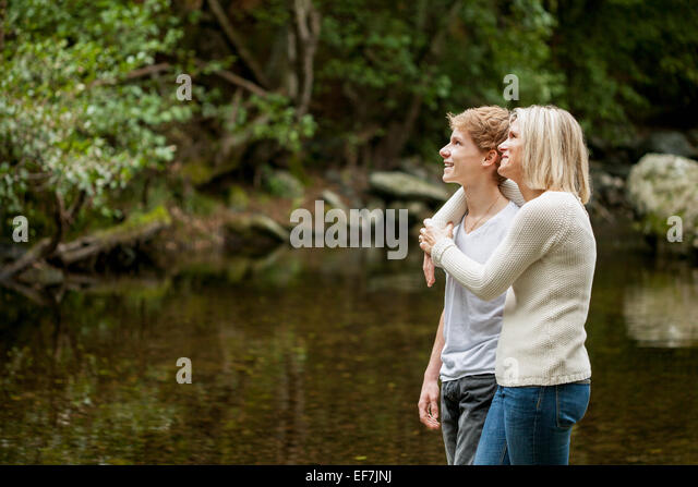 Mother and son enjoying in a park - Stock Image