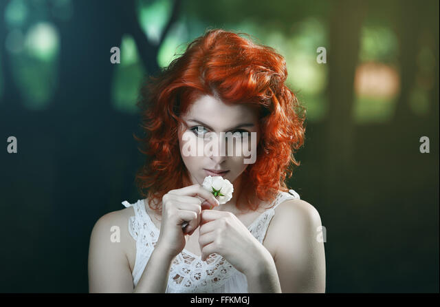 Beautiful pale vampire with red hair. Dark portrait - Stock-Bilder