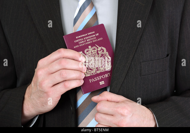 Presenting a British passport at the airport - Stock Image