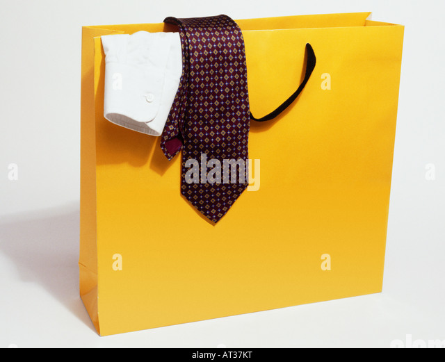 A carrier bag containing a shirt and tie - Stock Image