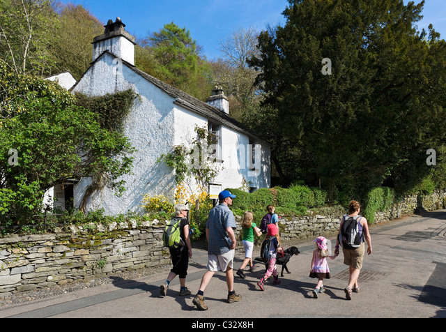Walkers in front of Dove Cottage (home of William Wordsworth), Grasmere, near Lake Windermere, Lake District, Cumbria, - Stock Image