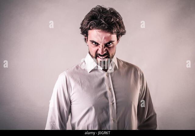 Man making grimace - Stock Image