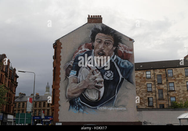 Glasgow Commonwealth Games Murals painted on sides of buildings, rugby, netball and hockey at Partick bus station - Stock Image