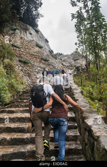 Locals, youth and tourists climbing the popular Cerro de Monserrate in Bogota, Colombia. - Stock Image