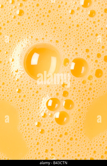 Close-up of beaten egg yolks with bubbles - Stock Image