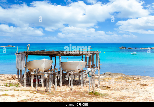 Beached boats in Formentera Els Pujols beach with turquoise water - Stock Image