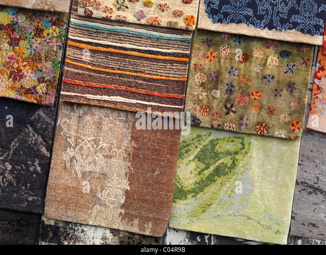 Colorful rugs on a display - Stock Image