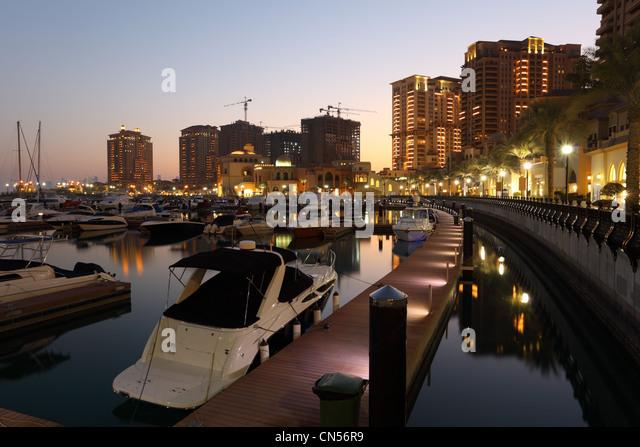 Porto Arabia at dusk. The Pearl in Doha, Qatar - Stock Image