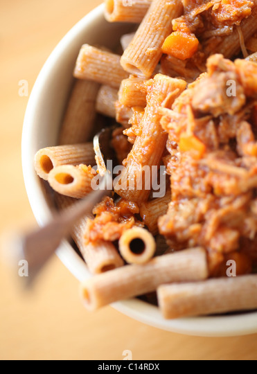 Rigatoni pasta with pork ragu - Stock Image