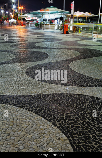 Wave Patterned Walkway with Kiosks at Night, Copacabana, Rio de Janeiro, Brazil - Stock Image